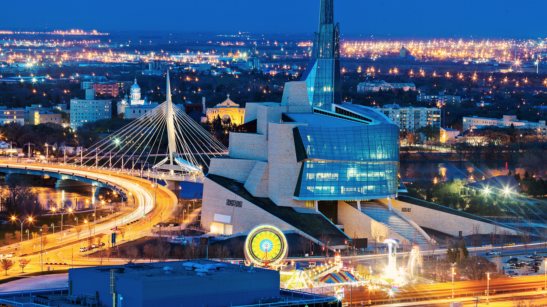 Winnipeg at night with the Canadian Museum for Human Rights in the foreground